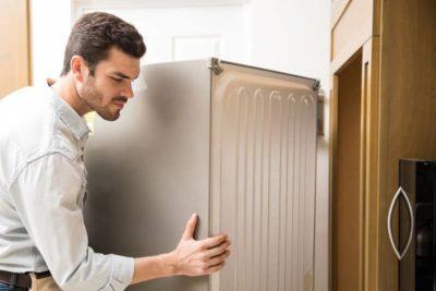 почему стучит холодильник при работе